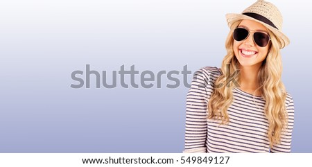 Composite image of gorgeous smiling blonde hipster posing with s Stock photo © wavebreak_media