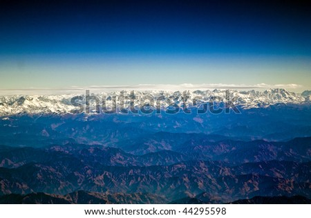 flying over the Himalaya in the morning with sunrise with severa Stock photo © meinzahn