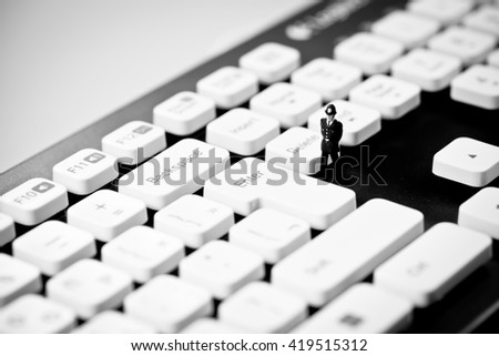 Miniature Police officer on top of computer keyboard. Internet p Stock photo © Kirill_M
