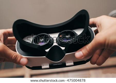 Man with virtual reality goggles enjoying 3d VR multimedia conte Stock photo © stevanovicigor