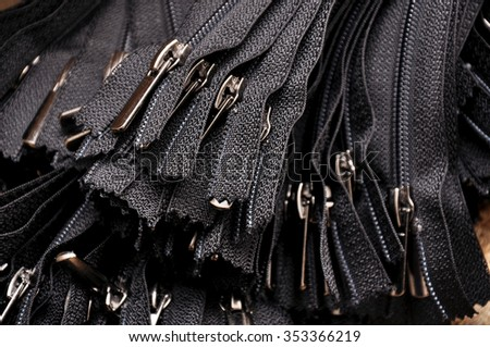 Tailor: colorful and many zipper for tailoring, sewing brown bac Stock photo © Yatsenko