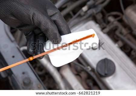 Measuring motor oil level in the car. New and clean engine lubri Stock photo © wellphoto