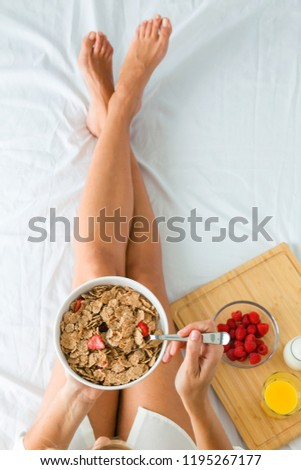 young beauty blond woman having breakfast in bed early sunny mor Stock photo © iordani