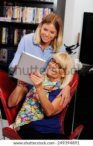 Senior citizen getting help from a social worker during a home v Stock photo © FreeProd