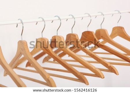 wooden empty clothes hangers on wooden background what nothing to wear concept woman clothing stock photo © virgin