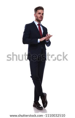 Satisfeito empresário em pé as pernas cruzadas palms branco Foto stock © feedough