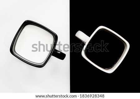 The glasses with dairy product milk standing on a black wooden table on a black. Natural organic dai Stock photo © artjazz