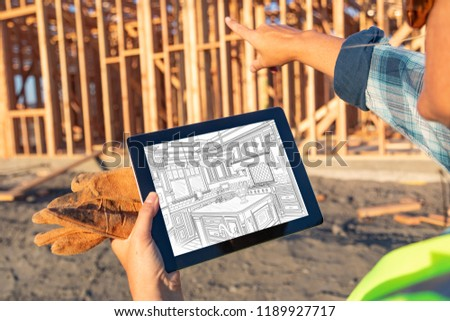 Female Construction Worker Reviewing Kitchen Drawing on Computer Stock photo © feverpitch