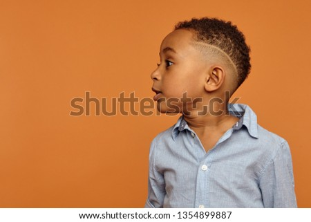 Portrait of satisfied african american boy having stylish afro h Stock photo © deandrobot