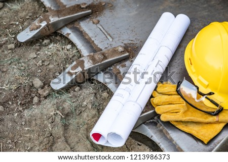 Hardhat, Gloves and Protective Glasses Resting on Bulldozer Buck Stock photo © feverpitch