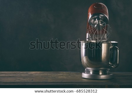 Kitchen metal beater on a black concrete background with copy space. Kitchen appliance for cooking.  Stock photo © artjazz