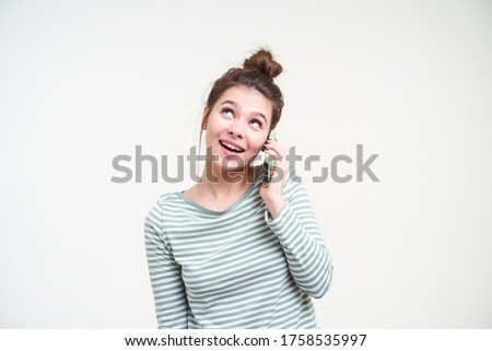 Image of pleased woman 20s wearing casual clothing talking on bl Stock photo © deandrobot