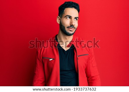 attractive smart casual man in leather jacket wearing red sungla Stock photo © feedough