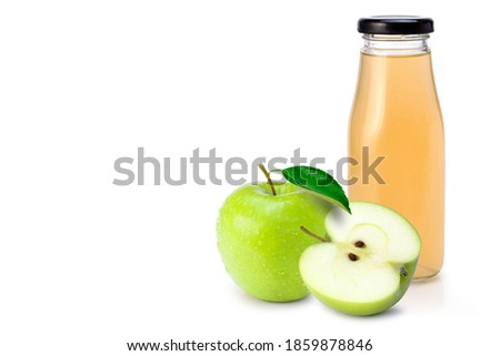 bottle of fresh organic apple juice with granny smith and british bramley apples in box on wooden ba stock photo © denismart
