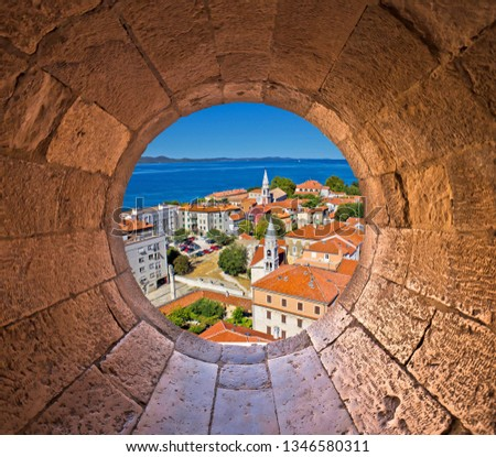 Colorful city of Zadar rooftops and towers view through stone wi Stock photo © xbrchx