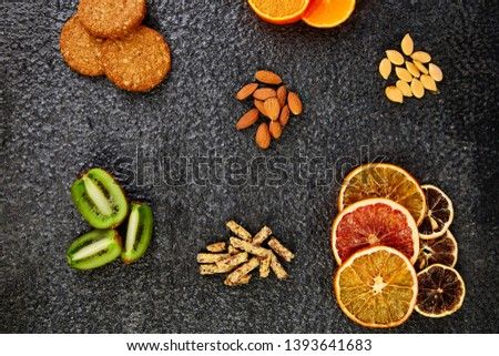 Healthy snacks -  variety oat granola bar,  rice crips, almond,  kiwi, dried orange stock fotó © Illia