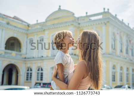 Mom and son on background of City Hall in George Town - Penang, Malaysia. British built historical b Stock photo © galitskaya