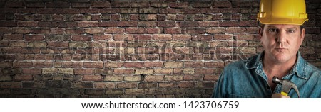Male Contractor In Hard Hat Holding Hammer In Front Of Old Brick Stock photo © feverpitch