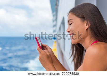 cruise ship woman using mobile phone on travel vacation at ocean girl texting sms on wifi on tropic stock photo © galitskaya
