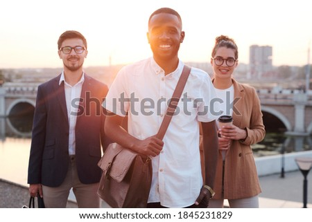 Young confident leader of team standing in front of two factory workers Stock photo © pressmaster