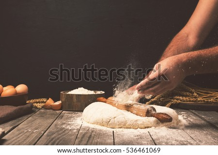 Male hands kneading dough sprinkled with flour table, Hands prep Stock photo © Freedomz