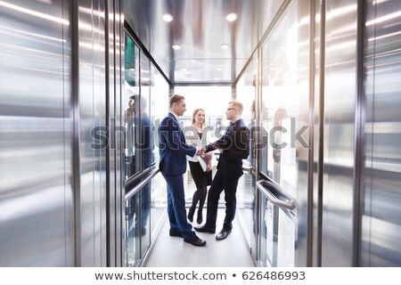 Businesswoman Discussing With Businessman In Elevator Stock photo © AndreyPopov