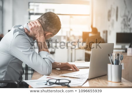 young injured male employee working in the office stock photo © elnur