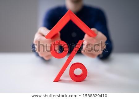Ev çatı yüzde imzalamak ipotek faiz oranı Stok fotoğraf © AndreyPopov