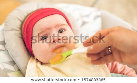 Madre hambriento seis mes edad Foto stock © Lopolo