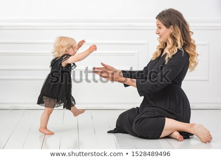 A daughter with is mother help with walker Stock photo © Lopolo