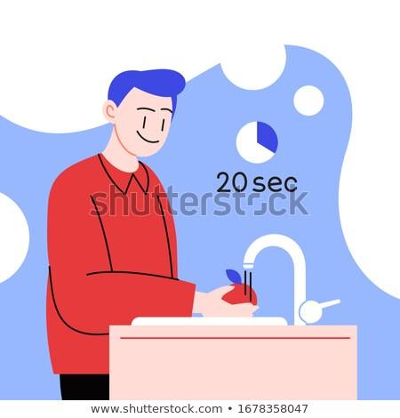 man washing fruits and vegetables Stock photo © nito