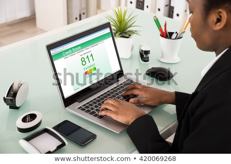 Businesswoman Checking Credit Score On Laptop Stock photo © AndreyPopov