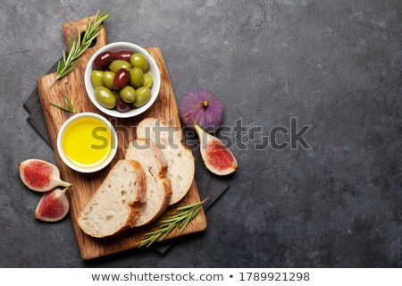 Ripe olives, figs, olive oil and ciabatta bread Stock photo © karandaev