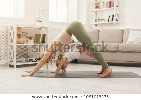 Beautiful blonde is making exercises stock photo © Pilgrimego