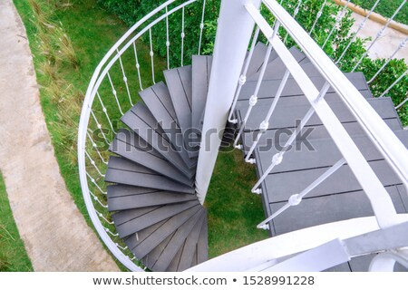 spiral staircase in the modern wooden house stock photo © lypnyk2