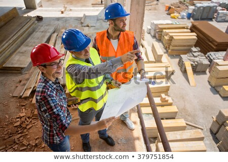 engineer open a blueprint project stock photo © stokkete