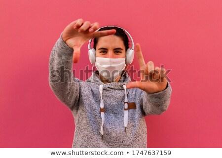 jovem · bela · mulher · fones · de · ouvido · branco · música · mão - foto stock © Rob_Stark