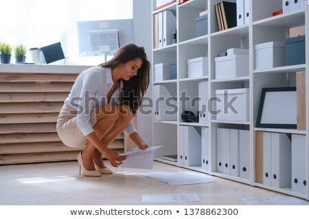 Stock photo: business woman dropping documents