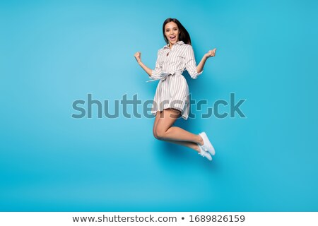 Stock photo: Happy brunette jumping