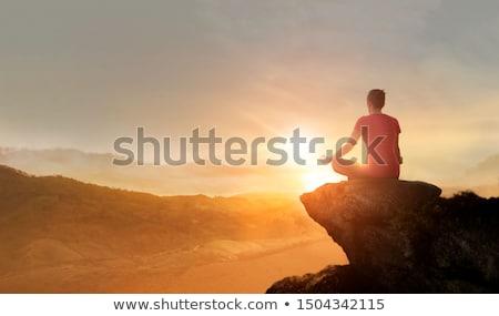 Meditáció hajnal férfi meditál óceán gyönyörű Stock fotó © Elenarts