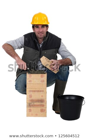 portrait of bricklayer against studio background Stock photo © photography33