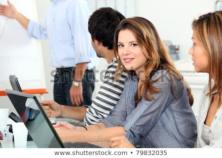 Vrouwen man achter computers luisteren vergadering Stockfoto © photography33