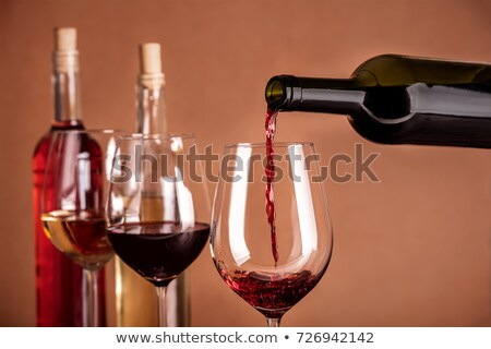 Rose and red wine bottle more a glass Stock photo © pedromonteiro