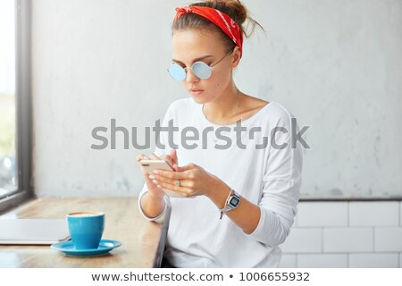 attractive female student holding mug of coffee and files Stock photo © photography33