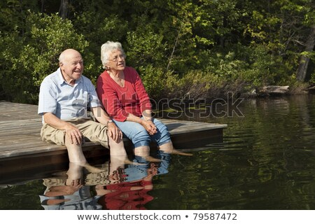 elderly woman enjoying a day out by the lake stock photo © photography33