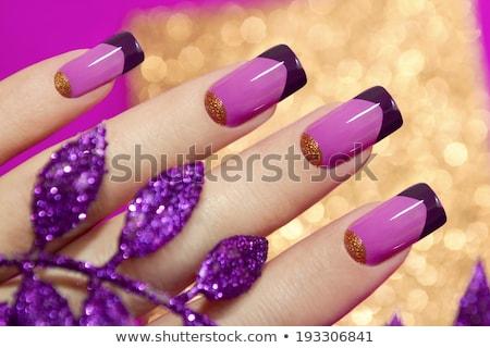 Deux mains rose acrylique clous blanche Photo stock © dolgachov