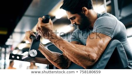 パワフル 若い男 重み 見える カメラ ストックフォト © stockyimages