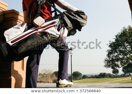 golfer holding golf bag stock photo © photography33