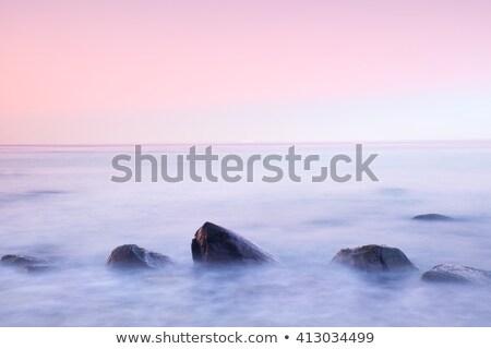 long exposure of beach and rocks Stock photo © yuliang11