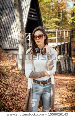 Brunette woman in front of chalet Stock photo © photography33